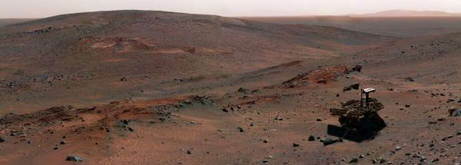 "The Spirit rover explores ""Husband Hill"" in April 2005. Five years after landing on Mars, the six-wheel robotic geologist and its twin, Opportunity, are still on the job. Photo: NASA/JET PROPULSION LABORATORY"