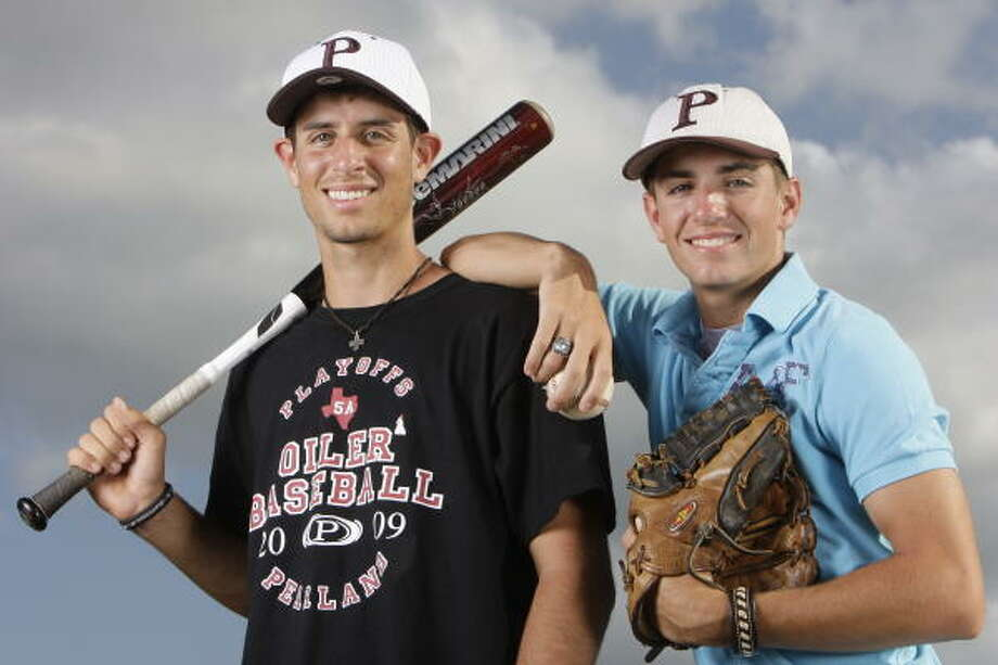 Pearland's Kelly, left, and Kyle Cross work well together when Kelly is catching and Kyle is on the mound. Photo: Melissa Phillip, Chronicle