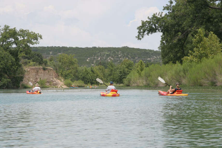 While water levels in stretches of many popular Central Texas rivers are so low they are nearly impossible to float, the spring-fed South Llano River near Junction continues to have enough flow to support paddlers. Photo: Shannon Tompkins, Houston Chronicle