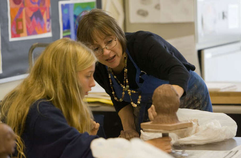 Art teacher Eileen McClellan works with student Anna Lunde, 12, a seventh-grader at West Briar Middle School. McClellan says art develops students' creativity and critical thinking skills. She has taught art for 27 years in HISD.  Photo: Johnny Hanson, Chronicle