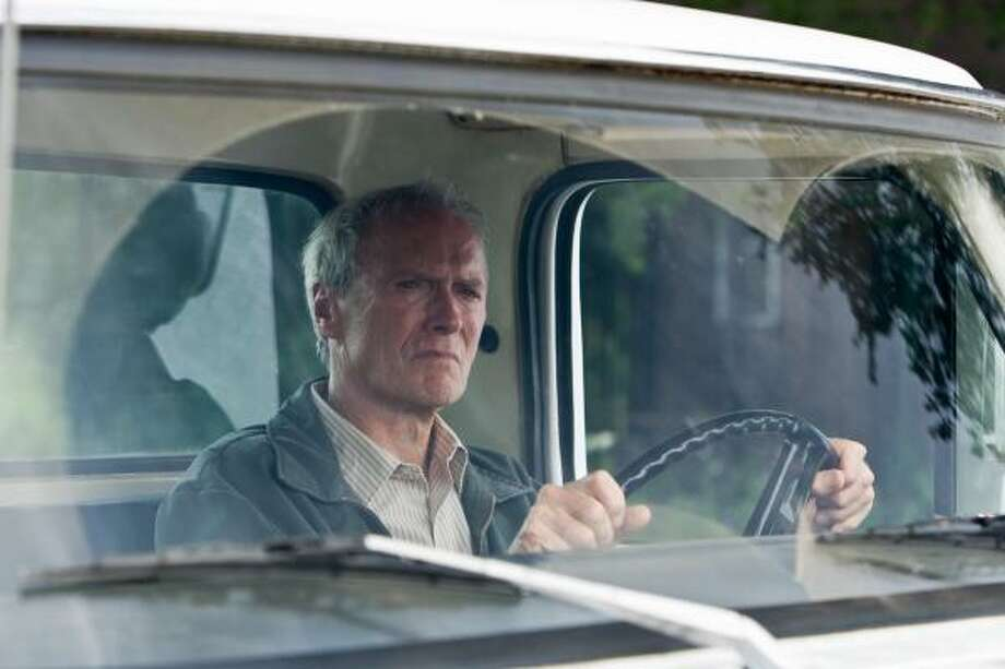 Clint Eastwood plays a grizzled Korean War veteran who mentors a young Hmong teenager who tries to steal his prized 1972 Ford Gran Torino. Photo: Anthony Michael Rivetti, WARNER BROS. PICTURES