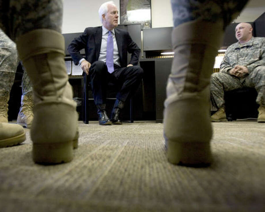 U.S. Sen. John Cornyn prepares for a news conference about recent suicides among Army recruiters. Photo: Johnny Hanson, Chronicle