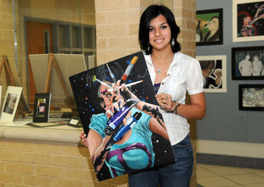 COLORFUL: Jeston Rodriguez is shown here with one of her paintings. Rodriguez was awarded a medal at the Youth Art Month awards for her triple self-portrait painting, which will now be exhibited at the State Capital building.  Photo: Kim Christensen, For The Chronicle