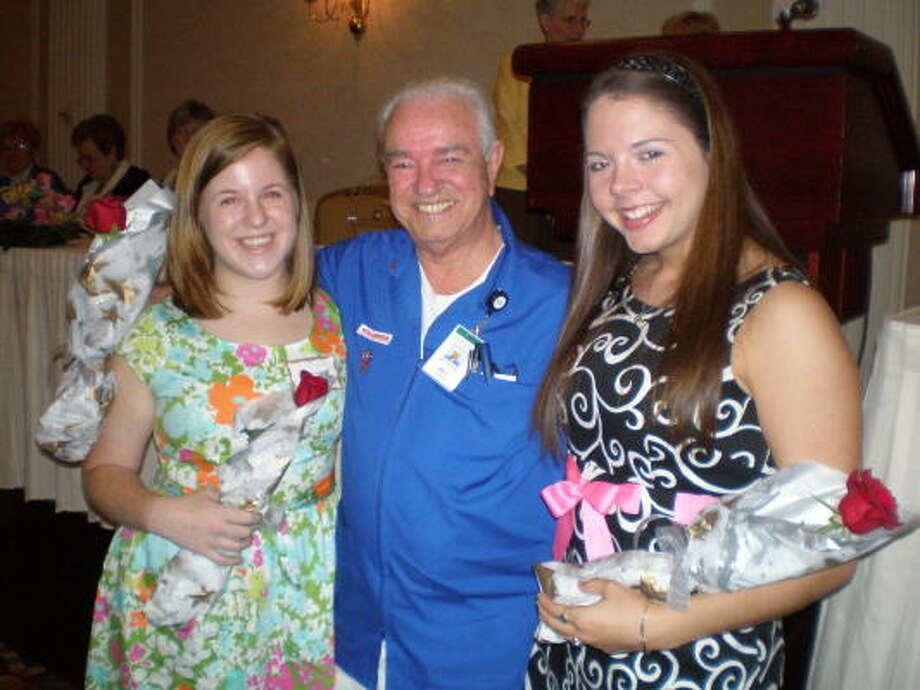 SCHOLARLY VOLUNTEERS: Memorial Hermann Northeast Hospital Volunteer Bill McDaniel proudly awards scholarships to Atascocita High School graduates and Junior Volunteers Allison Crawford, left, and Lauren Clifford.