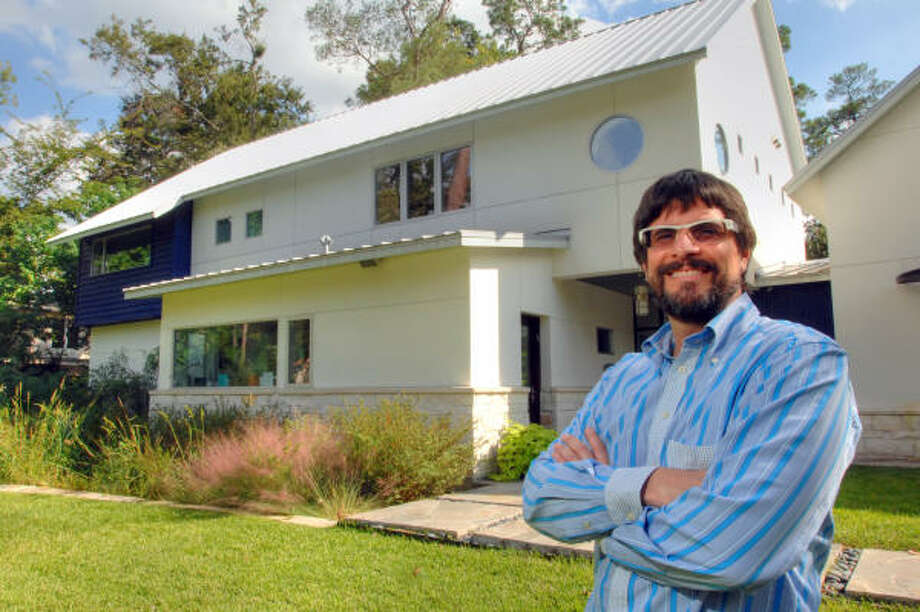 "Homeowner David Ronn and his ""green"" Houston home, a LEED-certified home built by Greenhaus Builders. Photo: Jerry Powers Photo"