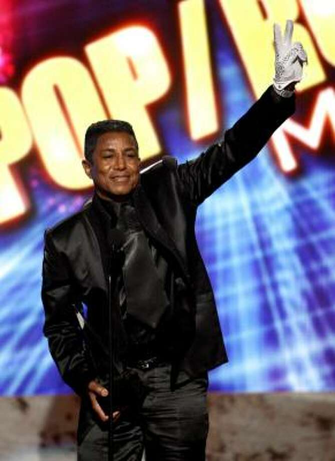 Jermaine Jackson accepts his brother Michael's award for Pop/Rock Music Favorite Male Artist at the 37th Annual  American Music Awards on Sunday in Los Angeles. Photo: Matt Sayles, Associated Press