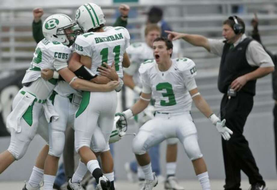 Brenham's Michael Buro celebrates his third-quarter touchdown pass during the win over Angleton. Photo: ERIC CHRISTIAN SMITH, FOR THE CHRONICLE