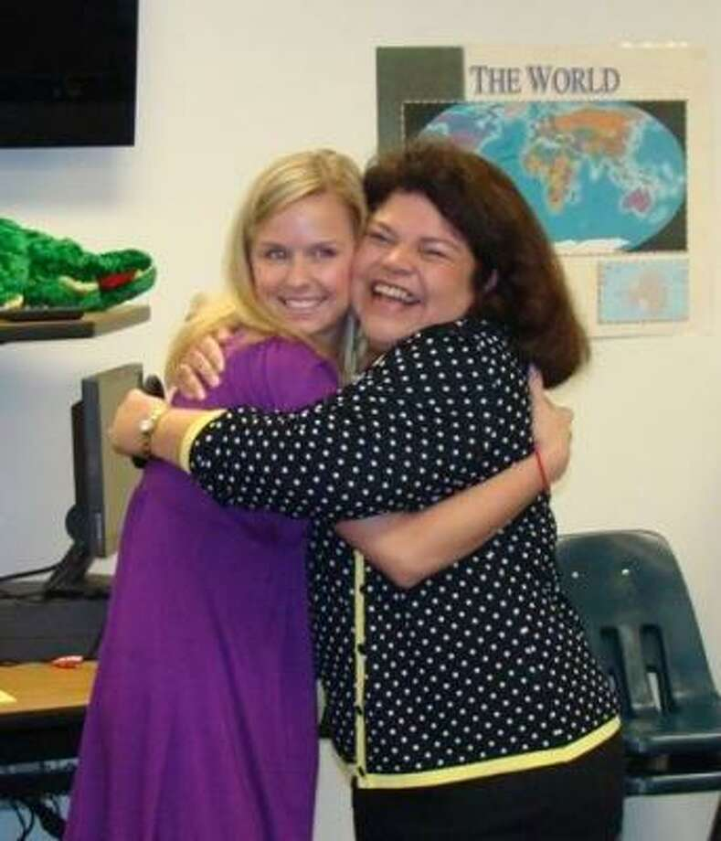 Katy Independent School District's 2009 Outstanding First-Year Secondary Teacher Jessica Byles received a congratulatory hug from Mayde Creek Junior High School principal Cazilda Steele. Photo: Courtesy, Katy ISD