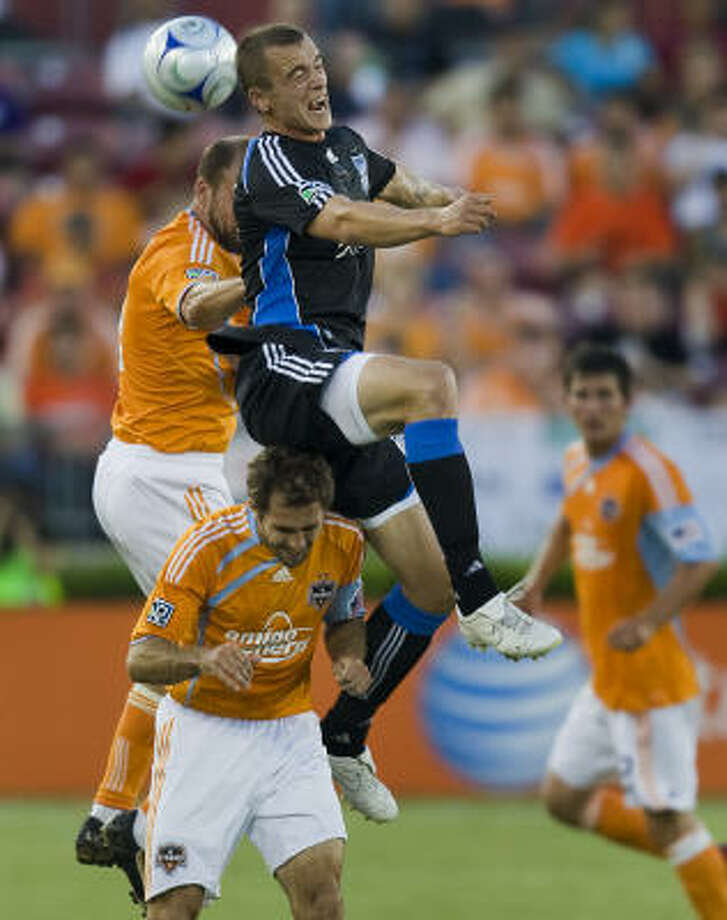 The Dynamo's Craig Waibel, back left, and Brian Mullan, bottom left, battle with new teammate Cam Weaver of San Jose at Robertson Stadium on  May 23. Photo: Smiley N. Pool, Chronicle