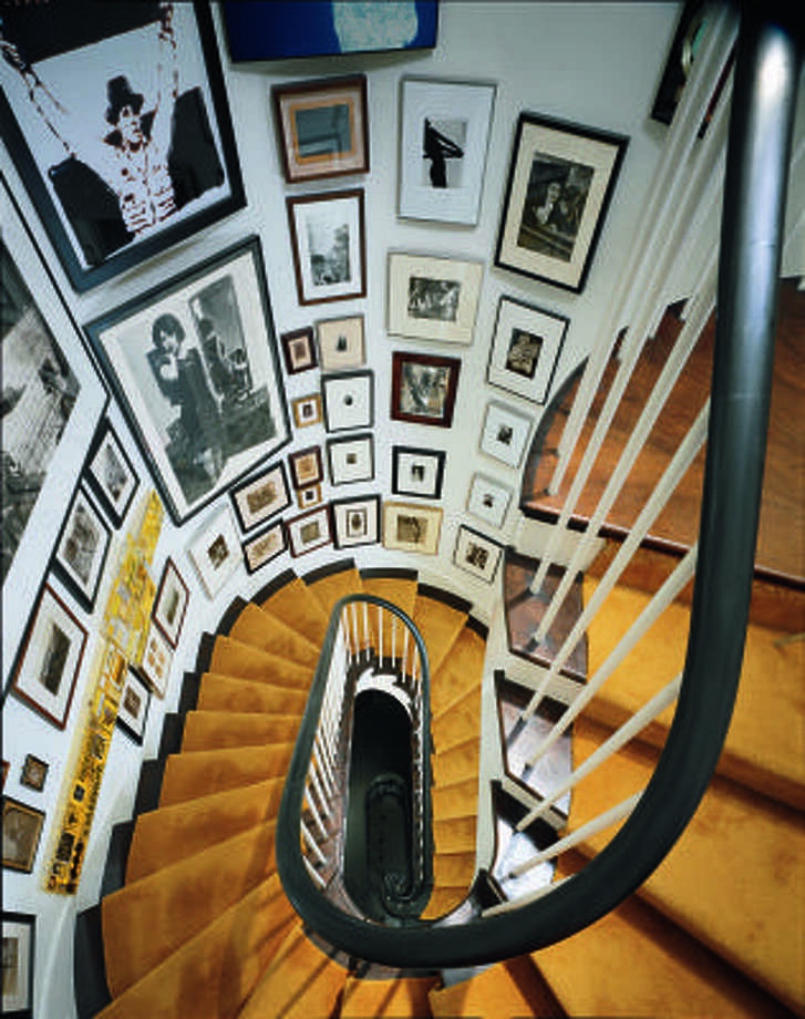 GRATIFYING GROUPING: An engrossing collection of photographs makes a townhouse stairway worth the climb. Photo: Krause, Johansen