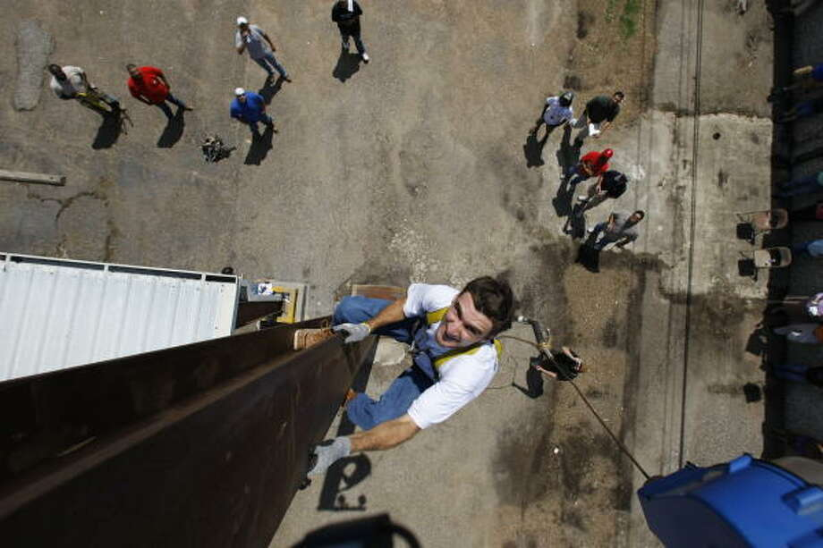 Joe Borders Jr. of Ironworkers Local 84 in Houston climbed the beam the fastest during a districtwide union apprentice competition on Wednesday. Photo: JULIO CORTEZ :, CHRONICLE