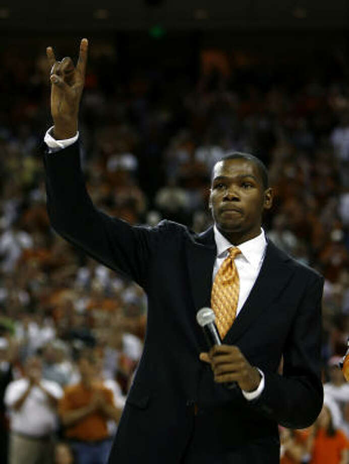 Former Texas basketball player and 2006-2007 National Player of the Year Kevin Durant gestures during a halftime ceremony in which Texas officially retired Durant's No. 35 jersey on Wednesday in Austin. Durant now plays for the NBA's Oklahoma City Thunder. Photo: Erich Schlegel, AP
