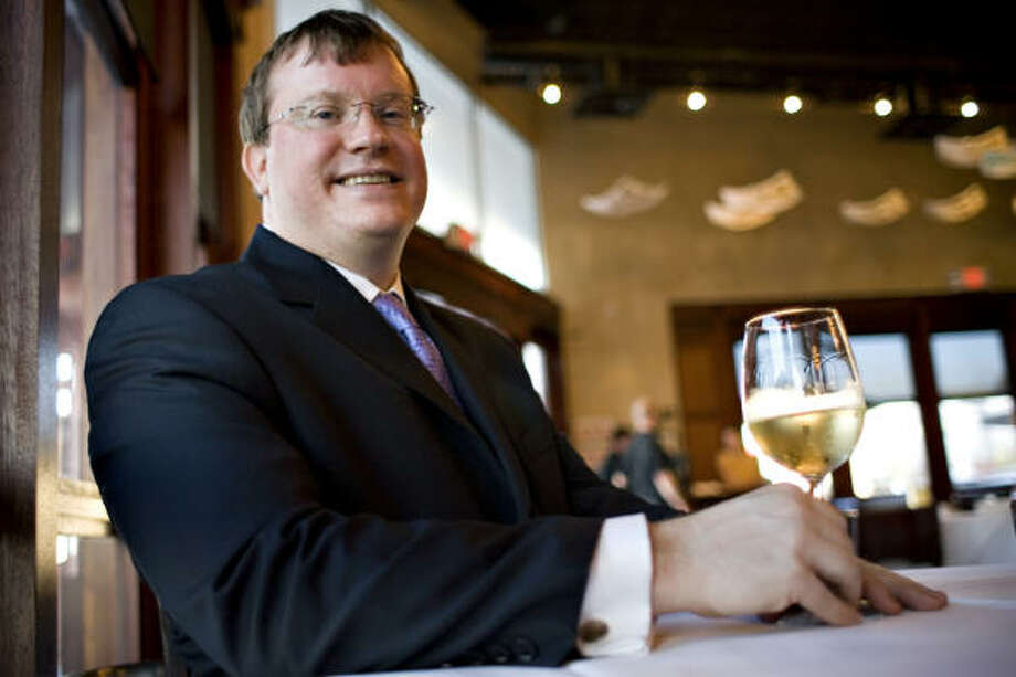 "Tony McClung, national sales manager for Rosenthal Wine Merchant, said he found the mood in Houston very different from most other places. ""There's a desire to know the story behind my wines and, once they know the story, there's interest in buying."" Photo: ERIC KAYNE, CHRONICLE"