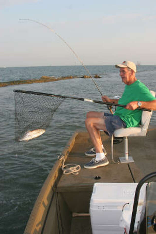 Good friends, light wind, green water lapping at a jetty and a bait well filled with live shrimp are ingredients for a fine summer morning of speckled trout fishing on the Texas coast. Photo: Shannon Tompkins, Chronicle