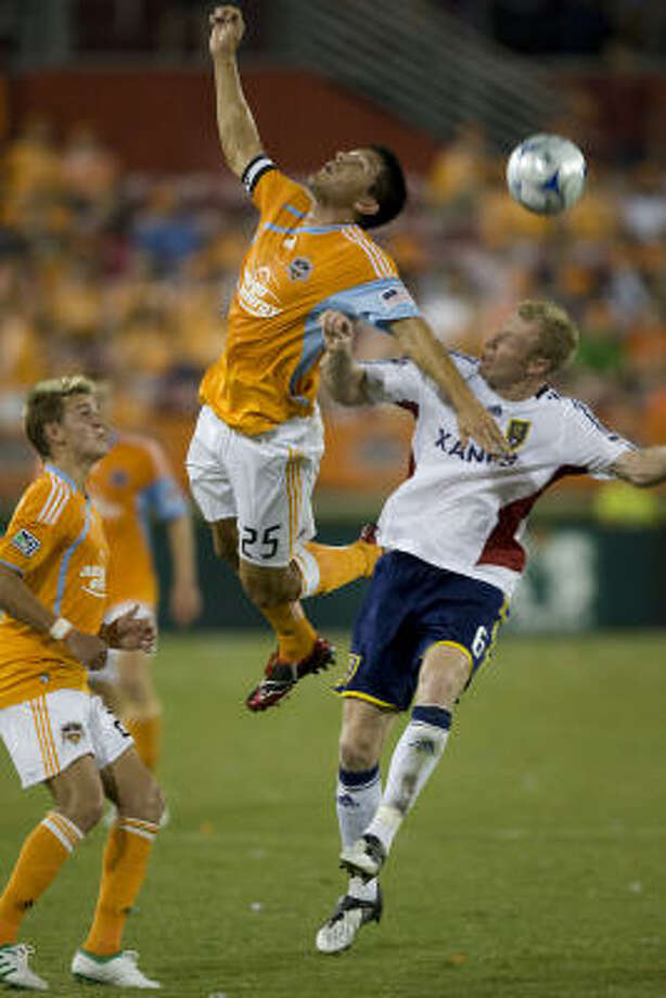 Dynamo forward Brian Ching (25) challenges Real Salt Lake defender Nat Borchers (6) for a header. Photo: Smiley N. Pool, Houston Chronicle