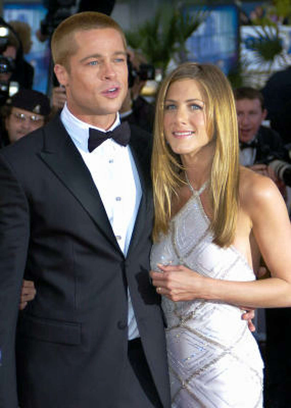 In a story posted on W magazine's Web site, Brad Pitt defends Jennifer Aniston and Angelina Jolie.