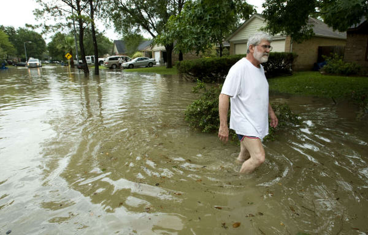 Nathan Wells' neighborhood in the Bear Creek subdivision was among those flooded last week when up to 10 inches of rain fell in less than eight hours.