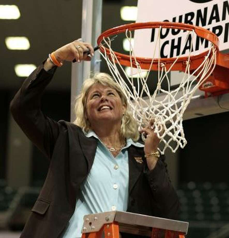 Texas-San Antonio coach Rae Rippetoe Blair cuts down a piece of the net after beating Texas-Arlington 74-63 in the Southland Conference tournament championship game. Photo: Bob Levey, AP