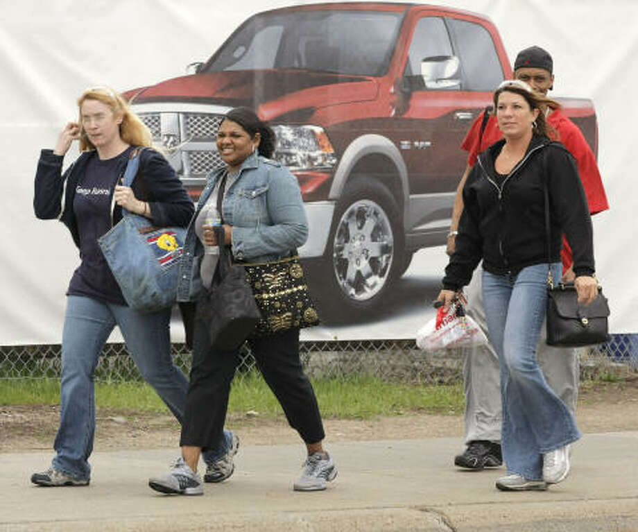Workers exit from the Chrysler truck plant this week in Warren, Mich. Their workplace wasn't on the list of plant closings that Chrysler plans. Photo: Bill Pugliano, Getty Images