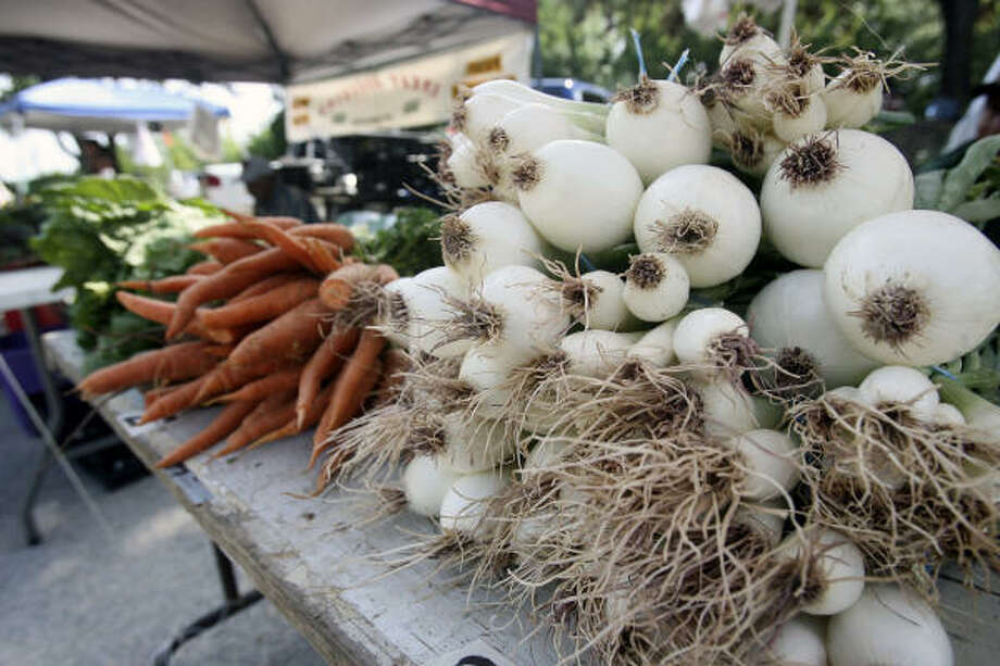 Farmers markets focus on locally grown, seasonal produce. Photo: TOM REEL, STAFF