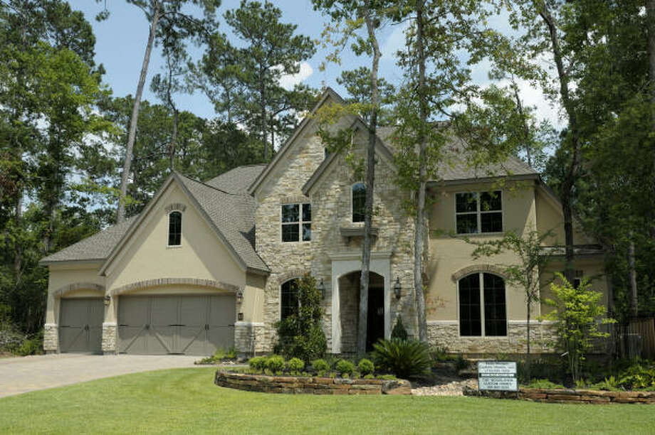 ONE OF MANY: Ready for move-in is the home at 43 East Black Knight Drive in the neighborhood of Kirkpatrick Glen, near the Gary Player Signature golf course, in The Woodlands' Village of Sterling Ridge. Built by Keith Morgan Custom Homes LLC, this 5,403-square-foot home is priced at $996,000.