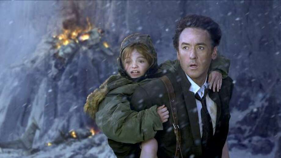 "Lily Morgan, left, and John Cusack star in a scene ""2012."" Photo: JOE LEDERER, ASSOCIATED PRESS 
