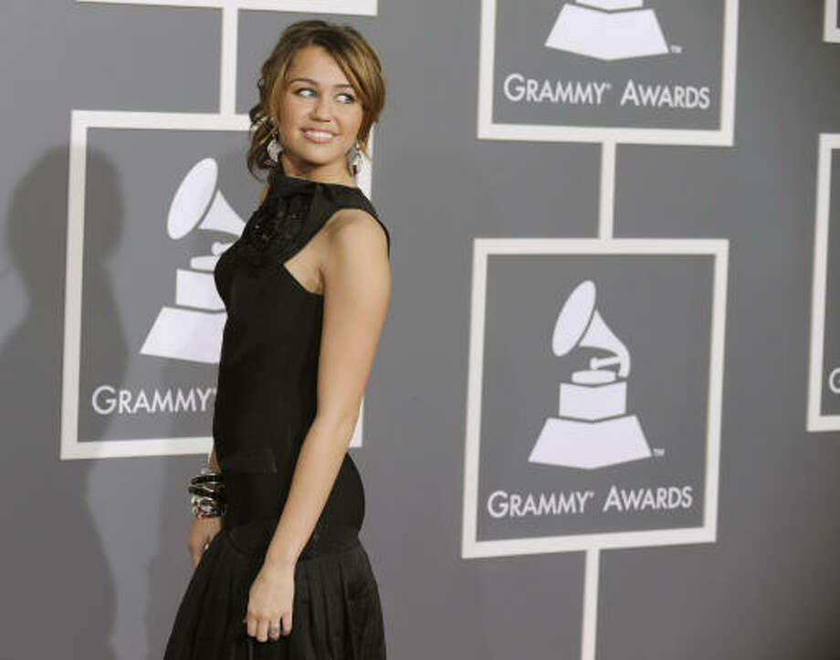 Miley Cyrus arrives at the 51st Annual Grammy Awards on Sunday. Photo: Chris Pizzello, AP