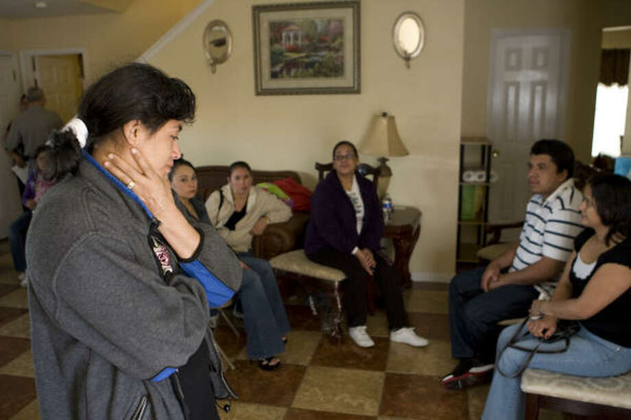A FAMILY MOURNS: Ana Benson, left, joins other family members in the Venturas' living room as they mourn the death of Jony Ventura and his daughter, Gabriela, in Houston on Sunday. Benson and her husband, Brett, were particularly close to Gabriela, their great-niece, who often visited their home near Dallas. Photo: Brett Coomer, Chronicle
