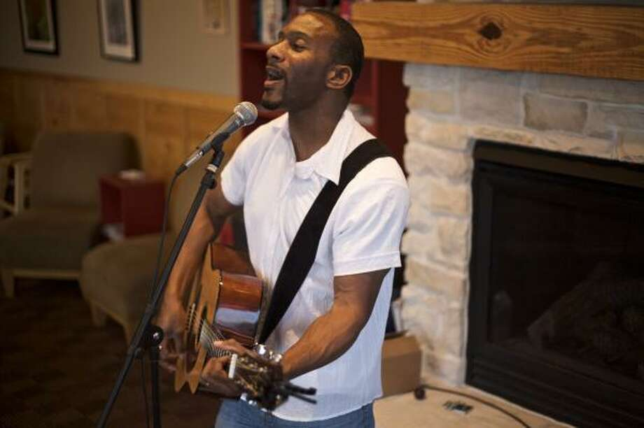 Tquan Moore performed May 21 at the Katy-area Dunn's Bros. Coffee. He is also scheduled to perform 7 p.m. June 4 at the coffeehouse at 6825 S. Fry Road. Photo: Maria-Patricia Cortez, For The Chronicle