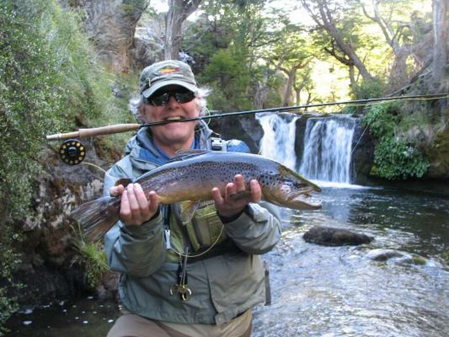 David Wilkes caught beautiful brown trout while wading a scenic, secluded river in Chile. Photo: Joe Doggett, Chronicle