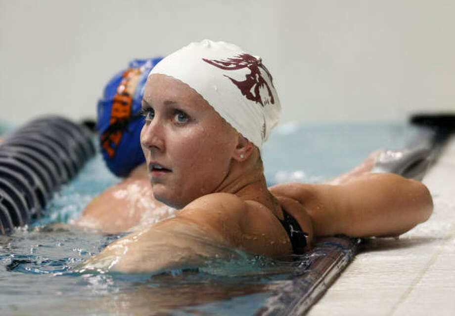 Jessica Hardy looks to the board for the results after she finished second in the 100-meter freestyle on Wednesday. Hardy's one-year ban for a failed drug test ended July 29. Photo: John Froschauer, AP