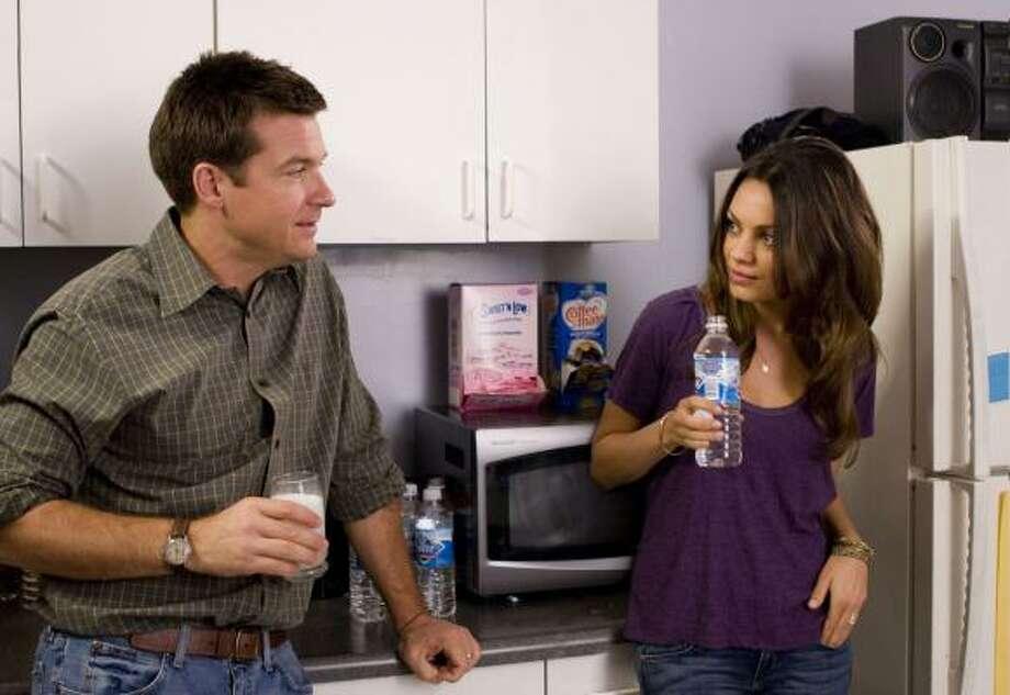 Jason Bateman stars as Joel and Mila Kunis stars as Cindy in Mike Judge's Extract. Photo: Sam Urdank, Associated Press