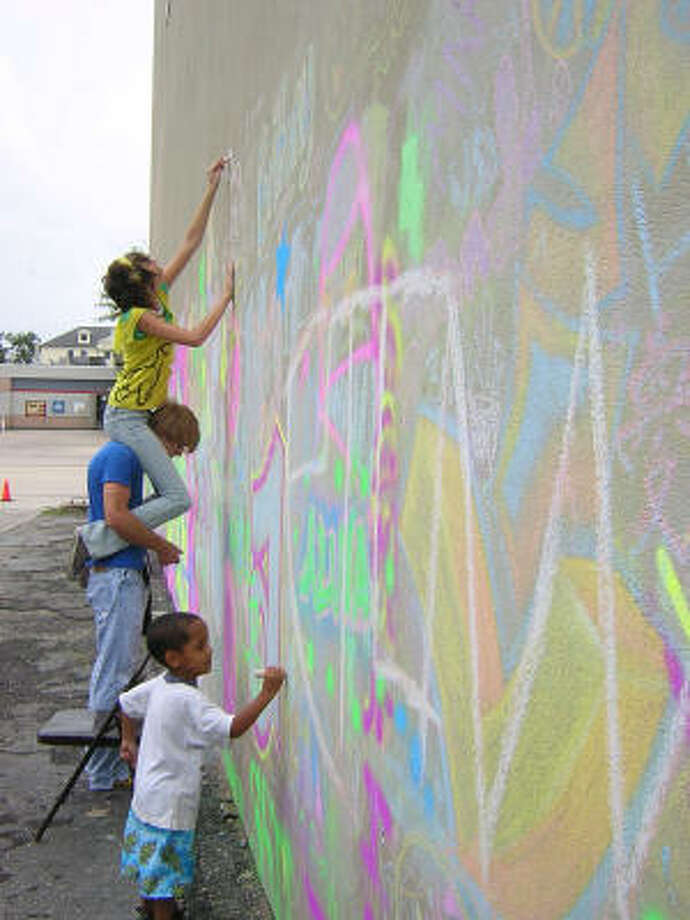 Among the free activities taking place during Museum District Day is decorating the back patio of the Lawndale Art Center with chalk, as visitors did during the 2007 event. Photo: Lawndale Art Center