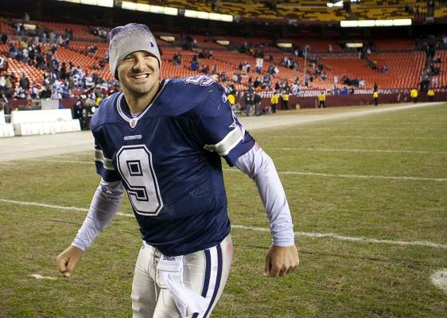 Quarterback Tony Romo and the Cowboys are all smiles heading into Sunday's regular-season finale against the Eagles. Photo: Evan Vucci, AP