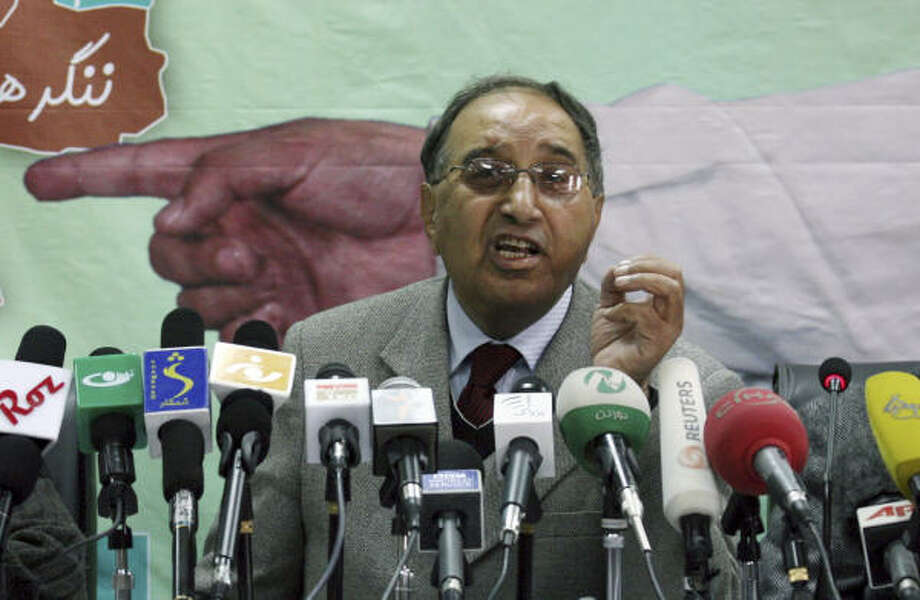 Azizullah Loden, head of Afghanistan's Independent Election Commission, speaks during a press conference at his office in Kabul, Afghanistan, today. Loden said that the country's presidential election will be held Aug. 20, when voters around the country will decide whether to keep President Hamid Karzai on the job. Photo: Musadeq Sadeq, AP