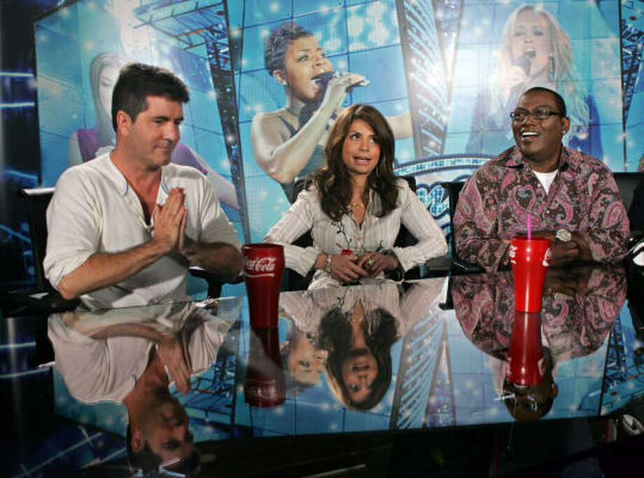 American Idol judges Simon Cowell, left, Paula Abdul, center, and Randy Jackson, right, as they answer a question at a news conference during 2005 auditions in San Francisco. Photo: PAUL SAKUMA, AP