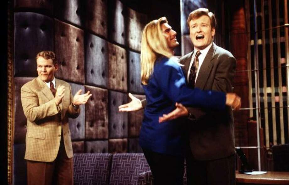 Conan O'Brien gets a hug from model Fabio back in 1997 as Andy Richter applauds. Photo: Associated Press