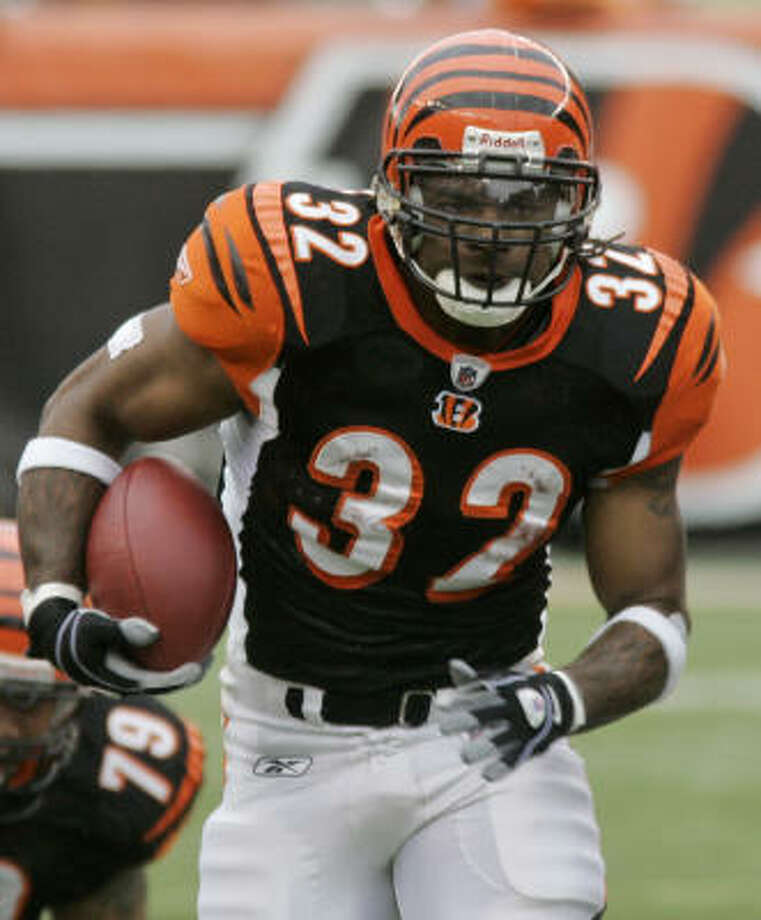 Returning to Texas would have made for a nice story for Cedric Benson, but re-signing with the Bengals was the better business decision, John McClain writes. Photo: Al Behrman, AP