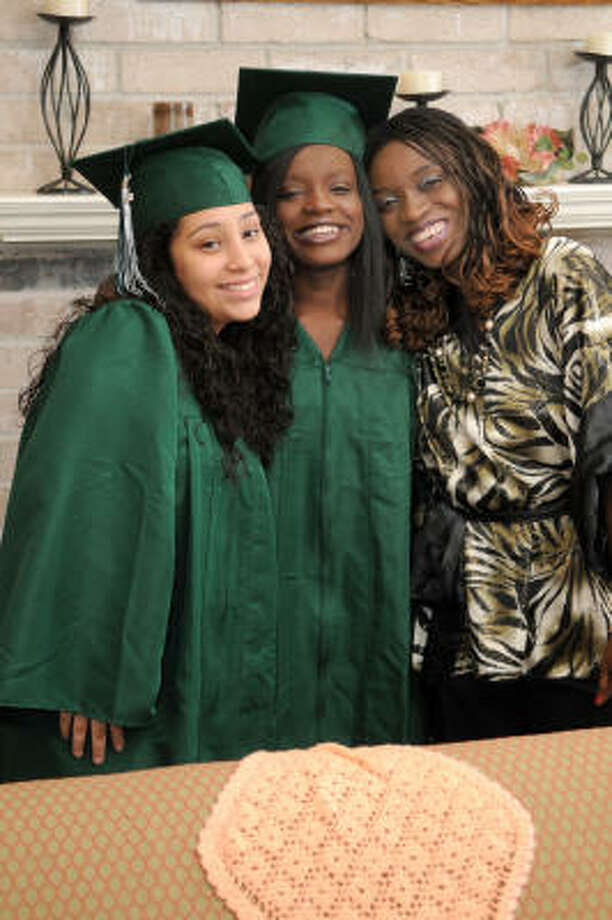 HAPPY TOGETHER: Viola Hakim, 19, center, with her mom, Margreat, right, and her best friend, Bianca Cedillo, 18, graduated from Spring High School June 2. Viola, along with her mother and two brother?s, lived in a tent in Kenya as Sudanese refugees before Kingwood Christian Church sponsored their permanent move to the U.S. eight years ago. Photo: Jerry Baker, For The Chronicle