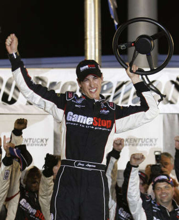 Joey Logano lifts his steering wheel into the air in front of his crew after winning the NASCAR Nationwide Meijer 300 auto race at Kentucky Speedway in Sparta, Ky., Saturday, June 13, 2009. (AP Photo/Ed Reinke) Photo: Ed Reinke, AP