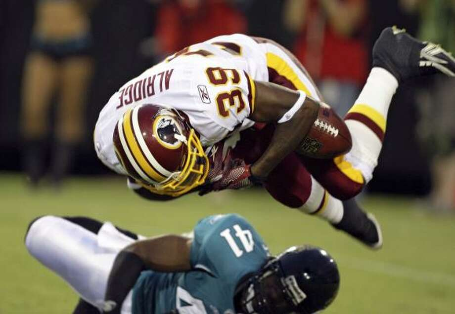 Anthony Alridge said fumbles cost him a spot with the Redskins in the preseason. This one was returned by the Jaguars for a touchdown on Sept. 3. Photo: John Raoux, AP