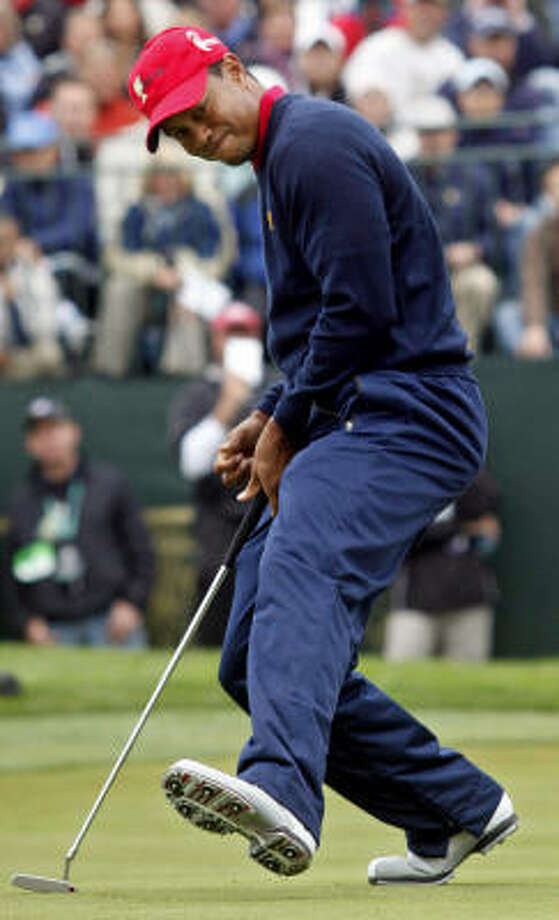 Tiger Woods delivered the clinching point Sunday with a 6-and-5 victory over Y.E. Yang, who beat him in the PGA Championship. Photo: Jeff Chiu, AP