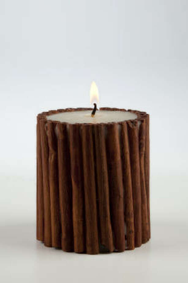 Scented candle rimmed with cinnamon sticks from Catch Fire. Photo: Smiley N. Pool, Houston Chronicle