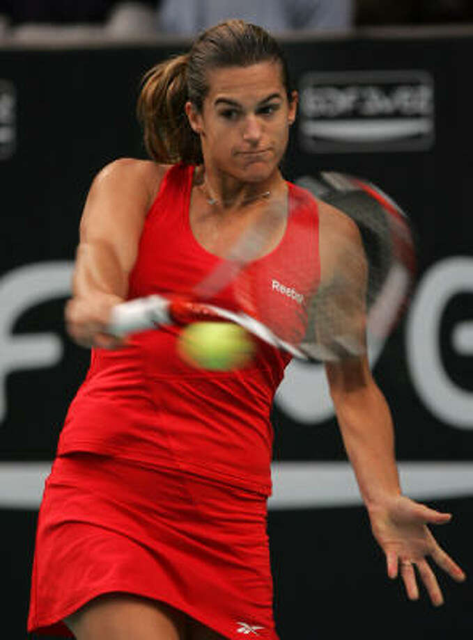 Amelie Mauresmo backhands the ball to Jelena Jankovic during Mauresmo's win in the semifinals. Photo: REMY DE LA MAUVINIERE, AP