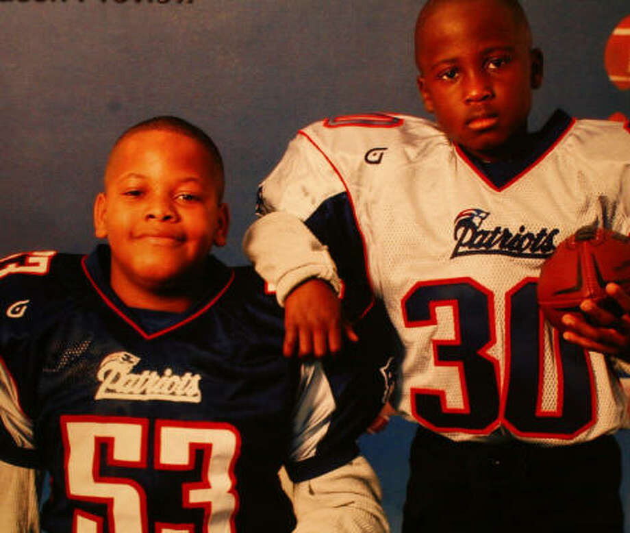 Brothers Malik Barlow, 7, and Dreton Thompson, 11, had a love for sports and for each other. Photo: Family Photo