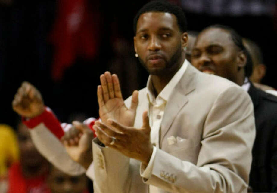 Tracy McGrady was on the bench for Games 3 and 4 against the Blazers, but his rehab schedule kept him from being there for the series-clinching victory. Photo: Nick De La Torre, Chronicle