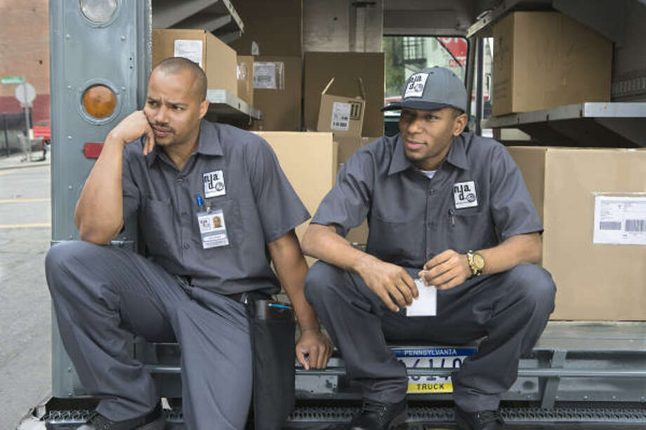 ADAM L. TAYLOR A NOT-SO-SPECIAL DELIVERY: Donald Faison, left, and Mos Def play mixed-up delivery men in Next Day Air. Photo: Photo Credit: Adam L. Taylor, ALL