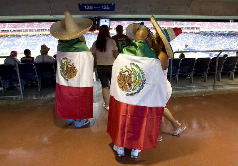 Mexico fans head to their seats during the CONCACAF Gold Cup match at Reliant Stadium. Photo: Brett Coomer, Chronicle