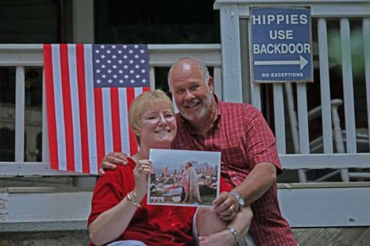 Bobbi and Nick Ercoline hold a copy of the original photo at their home in Pine Bush, N.Y.