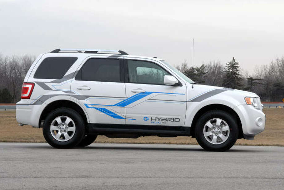 Ford's fleet of plug-in hybrid Escapes eventually will be equipped with the vehicle-to-grid communications technology. Ford and its energy industry partners have logged more than 75,000 miles on the plug-in hybrid test fleet. Photo: Wieck